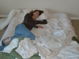 kelli sleeping on our air mattress